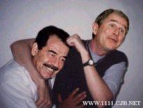 Picture of comedian Ernie Wise play wrestling with someone who looks like Saddam Hussein