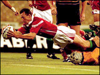Rob Howley scoring a try