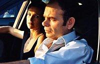 Carole Bouquet and Jean-Pierre Darroussin stuck in traffic in a scene from the film